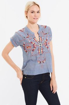 This Roberta Roller Rabbit embroidered  bohemian style top features richly colored embroidery and a shift-style body. Pair it with simple white pants or jeans for a stunning look.