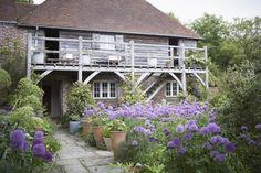 I visited Sarah Raven—gardener, writer, and TV personality—at her charming old dairy farm at Perch Hill in East Sussex, England and felt completely transported strolling around her garden. Like Sarah, it's loaded with ideas.