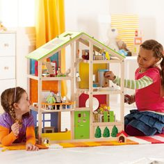 All Season House (furnished) | Hape Toys. The doll house has solar panels! Whoa.