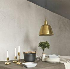 Iittala Christmas Home. Iittala + Time of the Aquarius collaboration. Nappula brass candleholders, Sarpaneva cast iron pot, Teema dishes and pitcher, Sarjaton glasses.