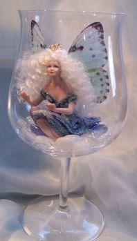 a fairy, hiding, during the Fairy Games (fairies cannot see through glass)