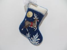 A needlepoint mini sock for stitcher, Karen S's, needlepoint Christmas tree.