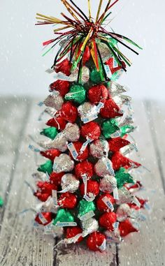 Love this! Make a chocolate Christmas tree using Hershey's Kisses.