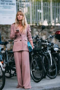 Jeanette Madsen wears a Love Child suit with a JW Anderson bag.