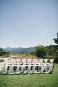 Budget Tip: Just decorate the last row of the chairs... See this wedding on #SMP here:  http://www.StyleMePretty.com/2014/04/17/pastel-colored-holman-ranch-affair/ -- Photography: DelbarrMoradi.com