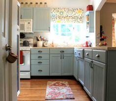 Painted Kitchen Cabinets- 'Rain' from Sherwin Williams. (Door and Trim paint) She used a roller, and then smoothed the paint with a brush; also added a bit of Floetrol to the paint to help make it have an even smoother finish. Chalk Paint Kitchen Cabinets, Blue Kitchen Cabinets, Kitchen Paint, Kitchen Redo, Painting Cabinets, New Kitchen, Kitchen Ideas, Mini Kitchen, Kitchen Colors