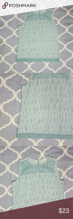 """Ann Taylor LOFT Blouse Teal/Cream Lacy Sz Medium Ann Taylor LOFT women's blouse. Size medium. Teal/cream. Lacy. Sleeveless. Career wear. 100% polyester. Length: 26""""  Chest: 20""""  In used condition. B1080&e Ann Taylor Tops Blouses"""