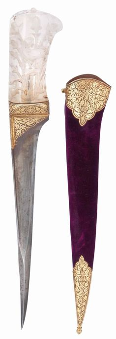 Indian (North) pesh kabz dager, 19th century, blade of typical straight single-edged form tapering towards the point, the reinforced point of square section, the forte and base of the hilt with possibly later gold-damascened decoration, the hilt deeply carved to receive inlay work now lacking, with motifs of birds in foliage, the velvet covered sheath with gold-damascened mounts, some corrosion 14¾in. (40cm.) long with sheath.