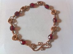 Echo Land Adornments - Love and Blood bracelet - Copper chain mail rosettes and wire wrapped red glass beads. Made for myself