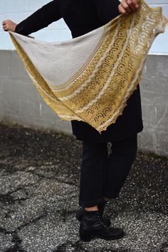 Worked in luxurious cashmere yarn, this pretty, half-pi shawl is worked from the top down. A border of simple lace patterns creates a dramatic effect contrasting with bands of rippling stripes. Find this pattern at LoveKnitting.Com.