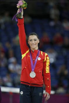 Silver medalist Romania's gymnast Catalina Ponor poses on the podium of the women' s floor exercise of the artistic gymnastics event of the London Olympic Games on August 7, 2012 at the 02 North Greenwich Arena in London.