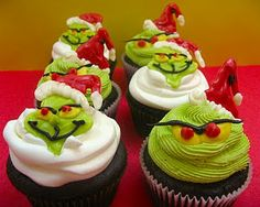 "Grinch Christmas Cupcakes. When you bite into them, there is a ""heart"" inside :)"