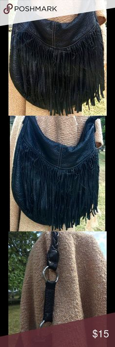 """Good used fringed American Eagle purse  American Eagle shoulder bag. In good used condition. Fringe is on one side and has zipper closure. Inside has two open storage compartments one one side, and a larger compartment with zipper on the other. 13"""" W, 11"""" H, 12"""" strap drop. American Eagle Outfitters Bags Shoulder Bags"""