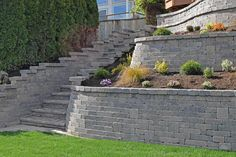 The integrated paver stairway leads down to the newly-installed sod lawn, providing a relaxing area to watch the activity and beauty of Lake Lawrence.