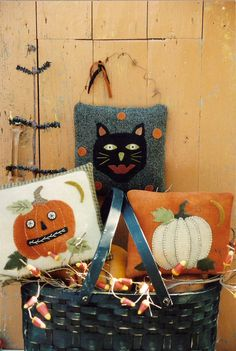 Fun seasonal pillows displayed in a black basket. Love it!