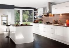 Enchanting Kitchen Design With Brown Wooden Backsplash And Gray Wall Shelves And Black Ceramic Floor Tile Combined With White Colors From Kitchen Cabinets And Island And Wall Storages Also Large Glass Door