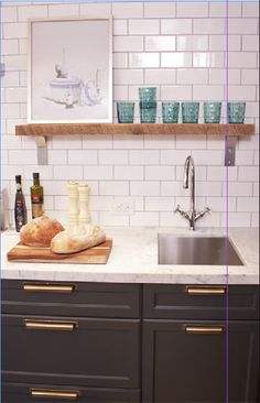 love the cabinets, counter top and subway tile.