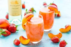 Strawberry Peach Wine Slushies are made with just a few ingredients and a blender. Mix them up for a night with the girls or a summer day by the pool! Alcohol Drink Recipes, Sangria Recipes, Wine Recipes, Smoothie Recipes, Cooking Recipes, Smoothies, Summer Drinks, Cocktail Drinks, Cocktails