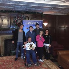 """Brett Connolly & David Pastrnak pose for a photo with their new friends from the Best Buddies organization before watching """"Elf the Broadway Musical"""" at the Citi Performing Arts Center."""