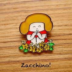 Zacchino!のゆるいオリジナルイラストをブローチにしました。線、着色ともにひとつひとつ手作業で丁寧に仕上げています。「たくさん咲いた」原っぱに黄色に花が... ハンドメイド、手作り、手仕事品の通販・販売・購入ならCreema。