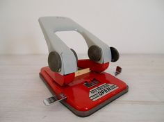vintage fire engine red hole punch by epochco