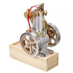 Vertical Hit and Miss Engine Metal IC Engine with Hand Start Device Gift CollectionA hit-and-miss engine is a type of four-stroke internal combustion engine that is controlled by a governor to operate at a set speed. This is a upgraded vertical . Nitro Engine, Gasoline Engine, Car Engine, Model Engine Kits, Mini Steam Engine, Water Generator, Oil Pipe, Combustion Engine, Great Teacher Gifts
