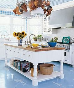Create your own elevated art with decorative ceilings and floors. Try painted stripes, botanical collages, or nautical charts. Anchor themed wallpaper and a stenciled motif on painted wood floors adds a playful touch to this classically coastal kitchen. New Kitchen, Beach House Kitchens, Kitchen Decor, Painted Kitchen Floors, Kitchen Island Design, Home Kitchens, Coastal Kitchen, Blue Kitchens, Kitchen Inspirations