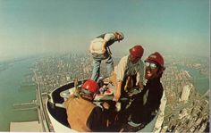 Moon Over Manhattan. This is an old postcard of...Local 40 Ironworkers NYC working on the former WTC's antennae. The top of the tower then...and today 05/10/13 they complete the spire of the new Tower 1. Truly astounding.
