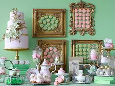 Inspired desert table of macarons and delish pastries...hmmm?  wonder if you take the cookies off the wall???