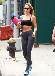 Earth Angel: Candice Swanepoel showcased her taut tummy while leaving ModelFit in Manhatta...