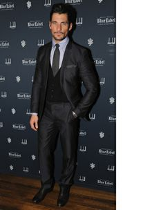 Model and race-car driver David Gandy makes the most of charcoal by mixing the lighter shade of his tie and pocket square with a darker suit. If you're envious of his groomed stache, check out our grooming guide and learn how to do pull off something similar.  Read More http://www.gq.com/style/blogs/the-gq-eye/2013/11/last-nights-must-see-menswear-11-27-2013.html#ixzz2lwDmbS5z