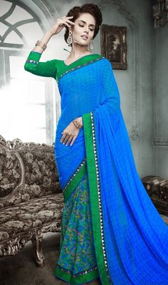 Create a stir with this blue printed faux georgette saree. The charming block print and lace work a intensive attribute of this attire. #GeorgetteColourfulPrintedSari