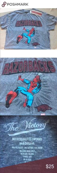 Arkansas Razorbacks T-Shirt Featuring Spider-Man! Arkansas Razorbacks T-Shirt Featuring Spider-Man! This rare shirt is size medium and is NWT. Support your favorite team with your favorite comic hero. Victory Shirts Tees - Short Sleeve