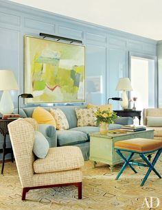A 1953 oil canvas by Yvonne Thomas dominates one of the light blue walls of the master suite's sitting room | archdigest.com