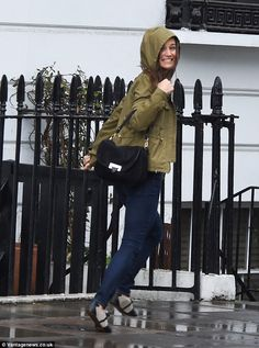 Making a run for it: A smiling Pippa Middleton dashes through the rain after being caught ...
