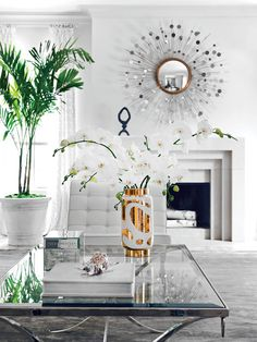 decorate with white and gold. sunburst mirror regency table