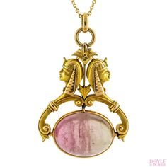 Art Deco Egyptian Revival tourmaline fob pendant with two pharaoh figures, in 14k yellow gold. Circa 1925, from Doyle & Doyle. 105891N
