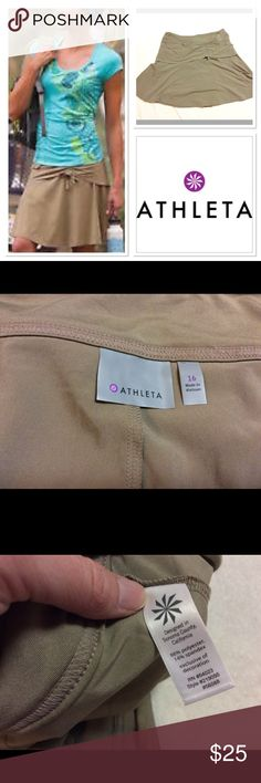 "16 ATHLETA khakina fitness skort in tan This skirt will keep you cool on the trails, and the best thing is it's a skort (built in shorts underneath)!  Measurements taken laying flat waist 18"", waist to hem 20.75"". Very stretchy and comfortable! Athleta Skirts"