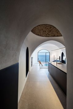 Pitsou Kedem has updated an apartment in the ancient port of Jaffa, Tel Aviv, adding arched windows and door frames to echo the vaulted ceiling