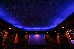 California Home Theater room with black lights on, and star ceiling visible. by nightskymurals, via Flickr