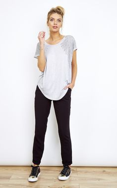 This simple tee has a unique twist with it's diamante encrusted shoulders. If you're looking for a basic grey tee with a modern twist, this is made for you!
