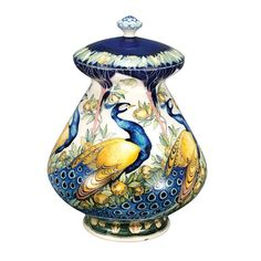 Galileo Chini Arte Ceramica Vase Florence, circa 1900 Of bulbous form, with a domed cover and squat finial, painted with a continuous frieze of blue and yellow striding peacocks in a lush landscape. Height 13 inches. Sold for $9,375 (Includes Buyer's Premium) Doyle NY