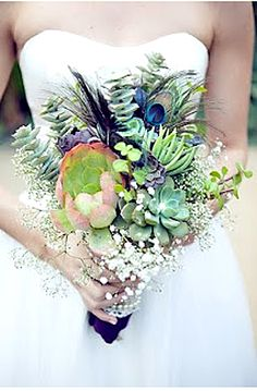 love this bouquet with succulents and peacock feathers