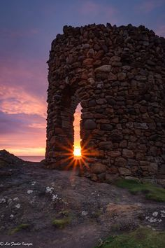 Sunrise through the arch at Lady's Tower, Elie, Fife, Scotland