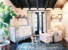 A touch of green makes such a difference, and I like the crib's being at an angle.