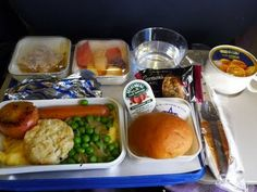 I understand this may be the definition of crazy, but when's the last time you unwrapped a three course meal, drank a glass of wine, and watched a movie? Definition Of Crazy, Domestic Airlines, Air Photo, Course Meal, Plate Design, Business Class, Break Room, Grubs, Flight Attendant