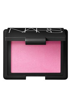 Adding a pop of color to the going out look with this bright pink Nars blush.