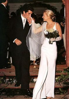 Carolyn Bessette wore a $40,000 pearl-colored silk crepe floor-length gown by Narcisco Rodriguez when she married John F. Kennedy Jr. Bessette paired the dress with a hand-rolled tulle silk veil, long silk gloves and beaded satin Manolo Blahnik sandals. Photo: Denis Reggie / Associated Press