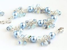 Winter Ice Cluster Bracelet II with light blue Swarovski pearls, Swarovski crystals, and sterling silver. By OpheliasJewels.
