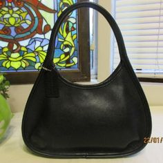 49fb47d6d0c1 The Coach Vintage Mini Ergo Black Leather Hobo Bag is a top 10 member  favorite on Tradesy.